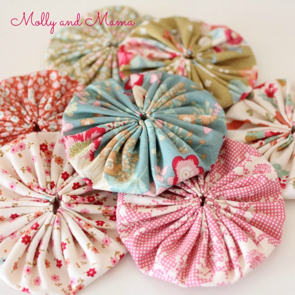 Tilda fabric yoyo's or suffolk puffs by Molly and Mama